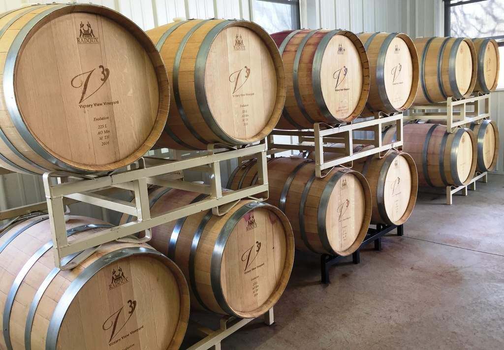 Oak barrels are racked and stacked in our winery.