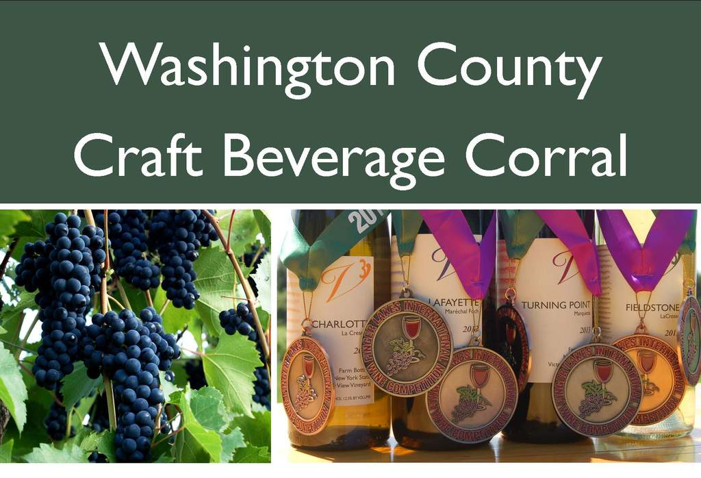 Victory View Vineyard at Craft Beverage Corral. Photo shows grapes and wine awards.